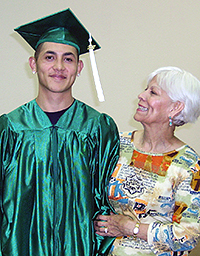 A male graduate in cap and gown