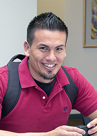 Smiling male student wearing backpack