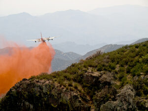 Plane dropping red slurry, Gladiator Fire, Crown King, AZ, Prescott National Forest, May, 2012