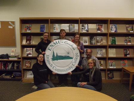 Students hold ENMU-Ruidoso image