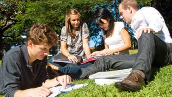 4 students study on lawn
