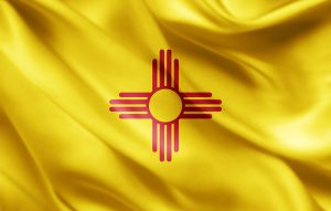 New Mexico symbol against yellow cloth